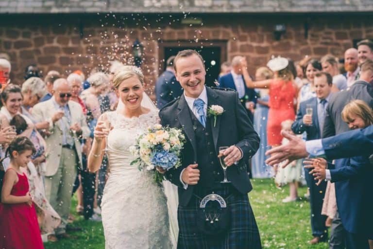 Bride and Groom with Confetti Throwing at Flanesford Weddings