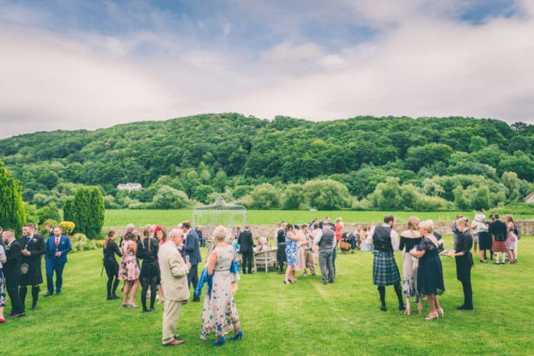 Wedding Guests on Lawn at Flanesford