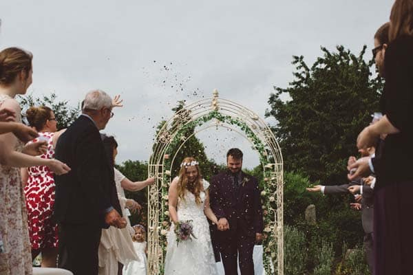 Bride and Groom with confetti at Flanesford Weddings